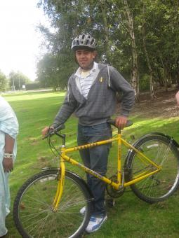 An asylum seeker with his new bike, given by the Red Cross in Hull